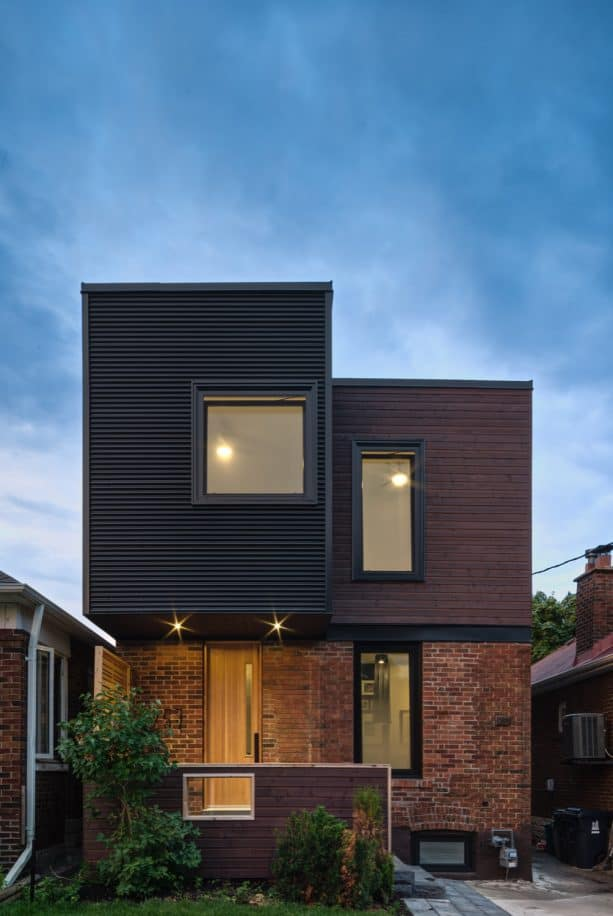 a contemporary exterior with half mixed-red brick and half metal siding combination