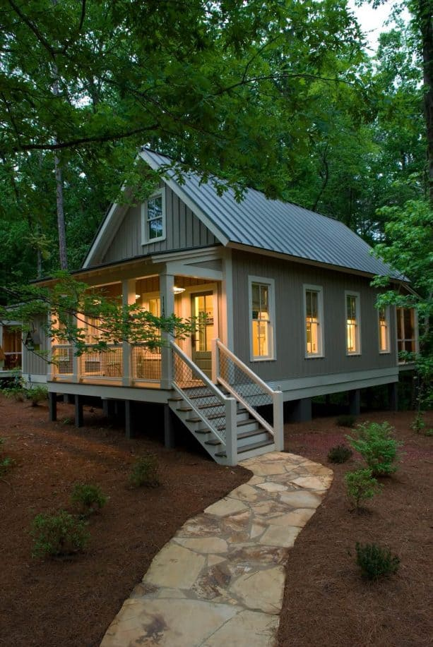 a small grey mountain home with bone white trim
