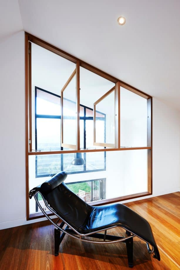 an interior window in a contemporary room with equal height and position with the exterior window in the next room