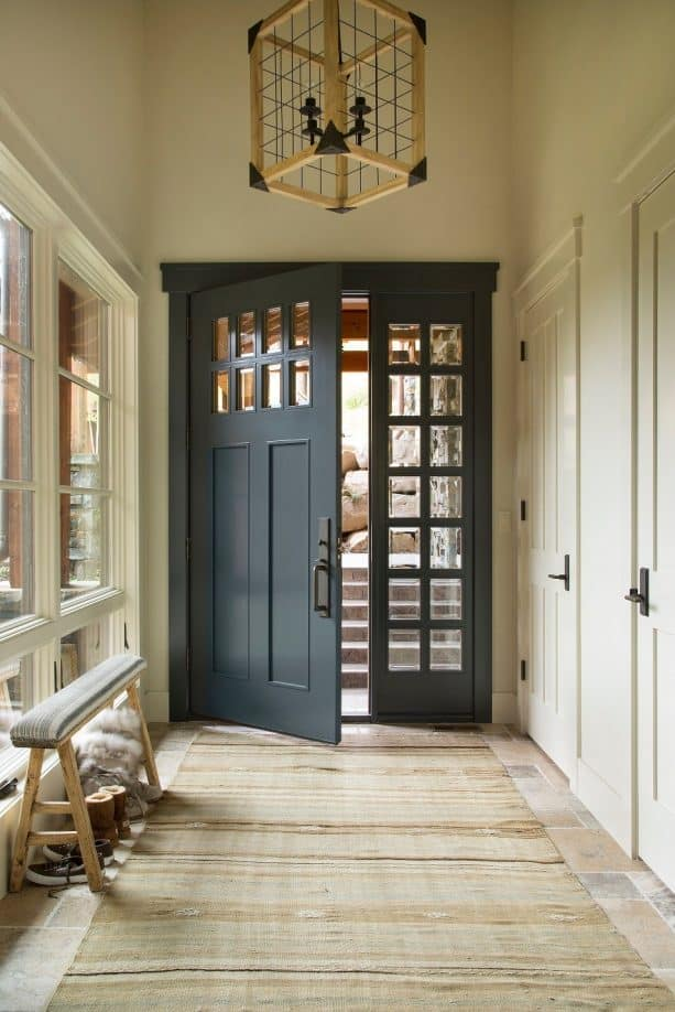mountain style entryway with a benjamin moore midnight dark blue front door