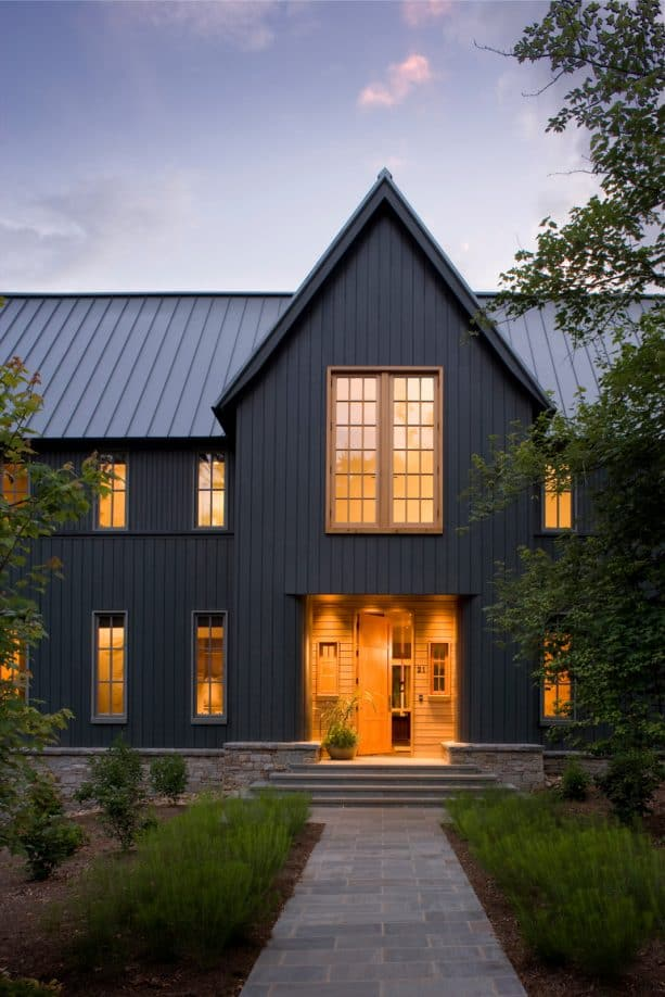 transitional house with a combination of metallic grey metal roof and hague blue estate emulsion color paint siding