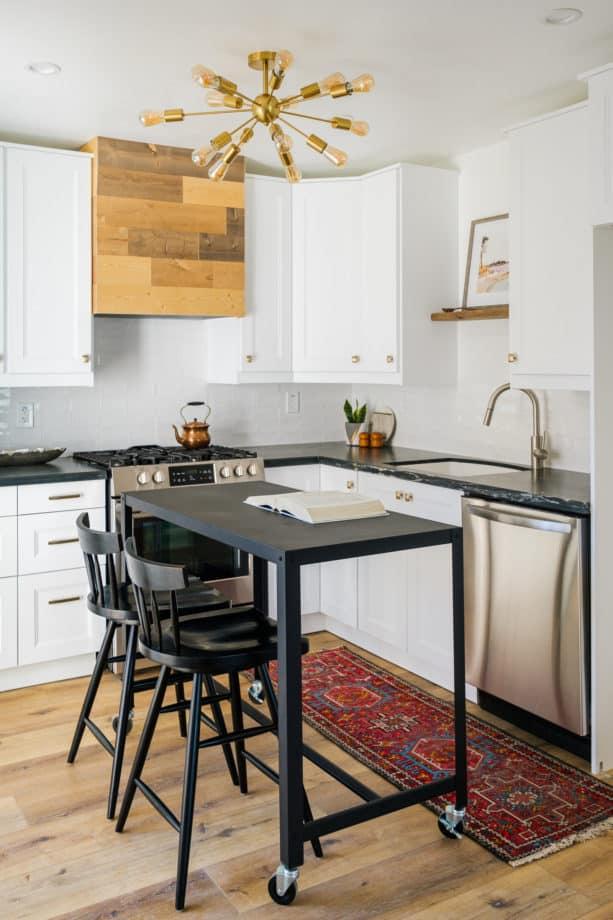 tiny cozy kitchen with white ikea cabinets and black quartzite countertops