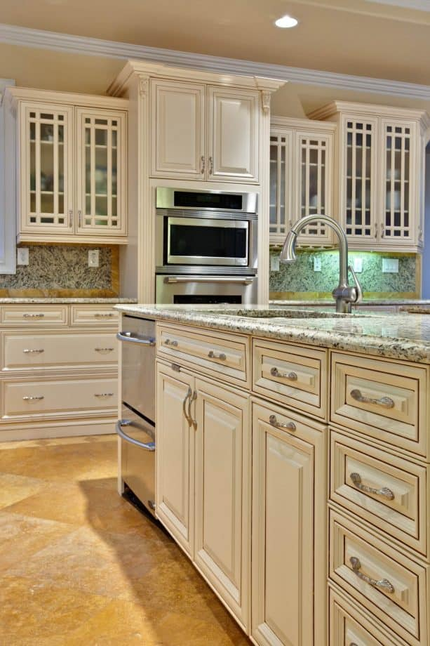 traditional kitchen with antique white maple cabinets with glaze