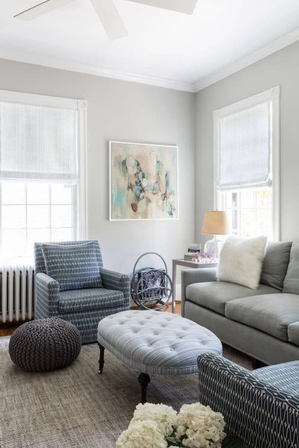 grey and blue transitional living room with cloud grey oval tufted ottoman