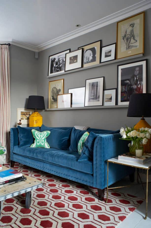 transitional grey and blue living room with sangria red rug