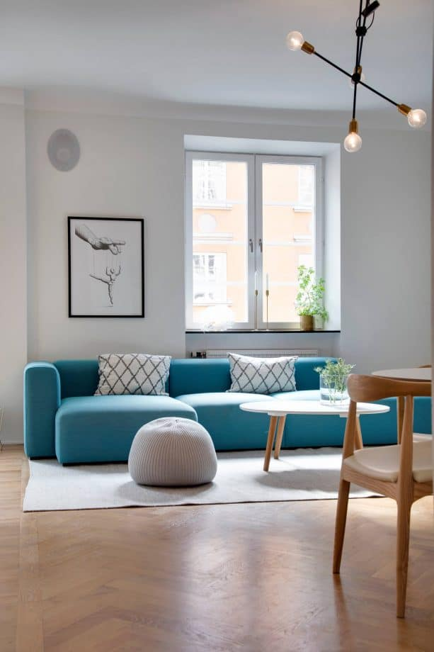 grey and teal living room with minimalist design