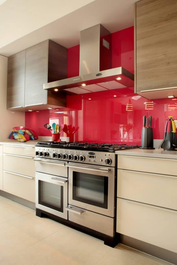 cream cabinets and red backsplash