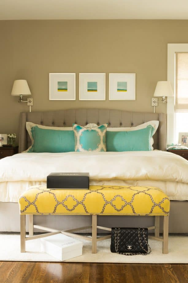 grey room with patterned yellow bench