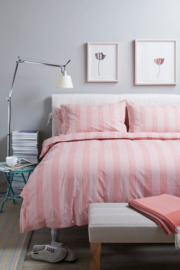 pink and grey bedroom with a purplish wall