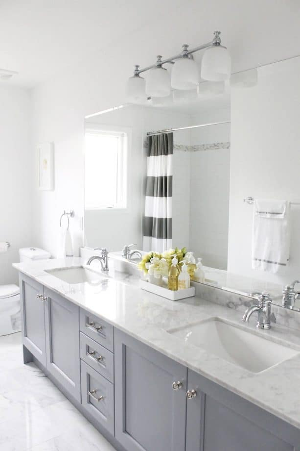 grey and white bathroom with stripes shower curtain