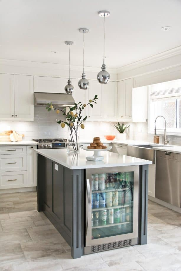 white shaker cabinets paired with stainless-steel appliances and range hood