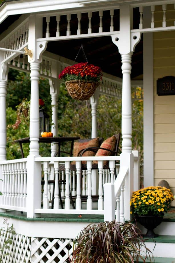 Victorian porch with white turned baluster railing