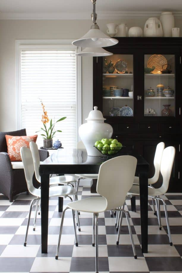 a traditional dining room with black and white vinyl floor