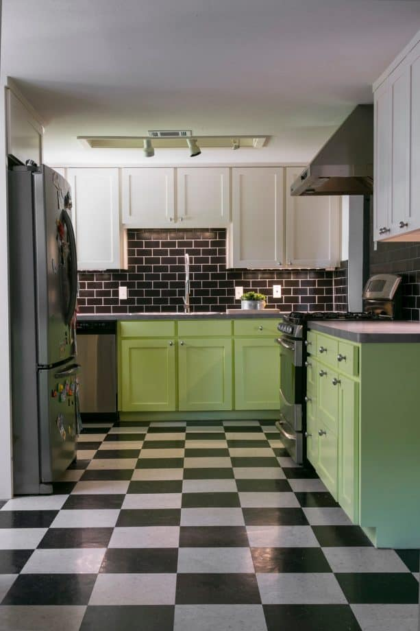 black and white vinyl tile floor paired with green cabinets