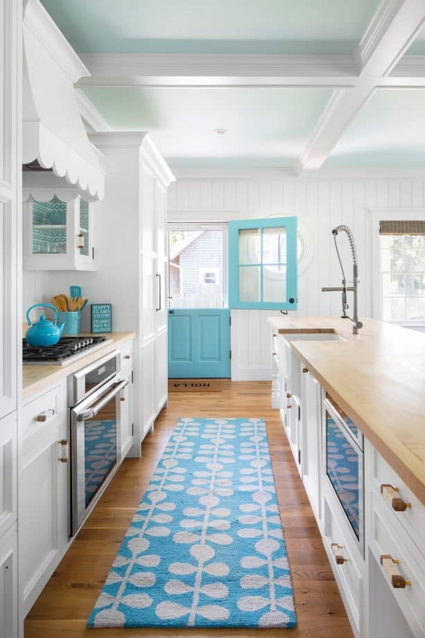 white, turquoise, and light brown color scheme in a beach-style kitchen