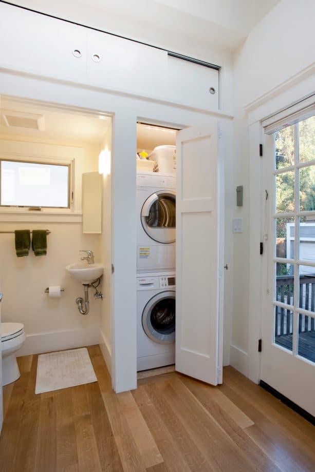 a mini laundry closet with folded door