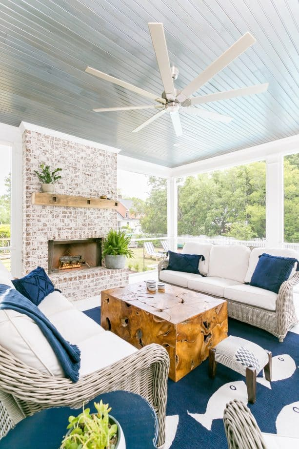 fabulous beach-style screened porch with white and navy-blue color theme