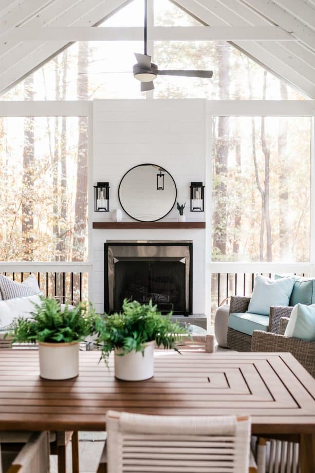 rustic-modern screened porch with modern fireplace decorations