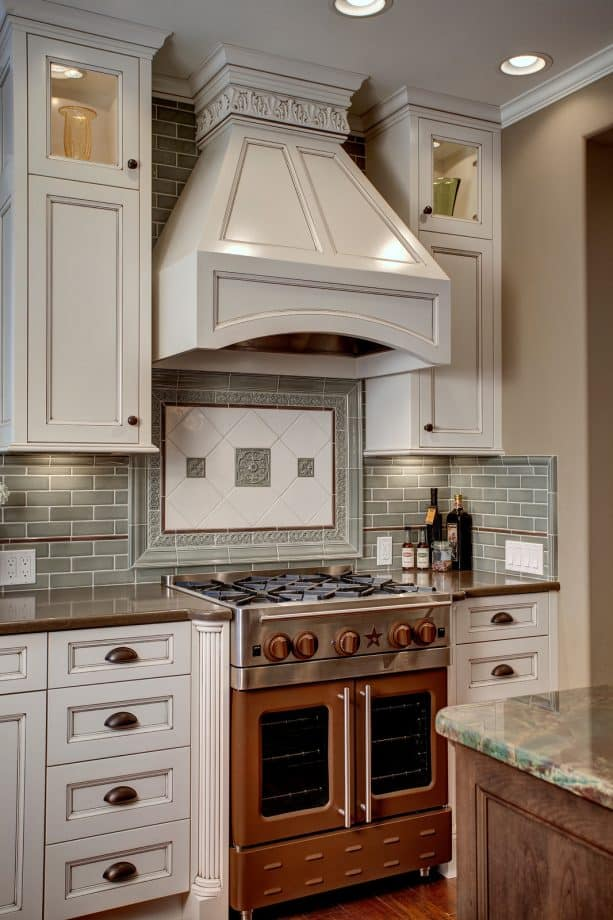 gorgeous combination of brown oven-stove, brown countertops, and white cabinets