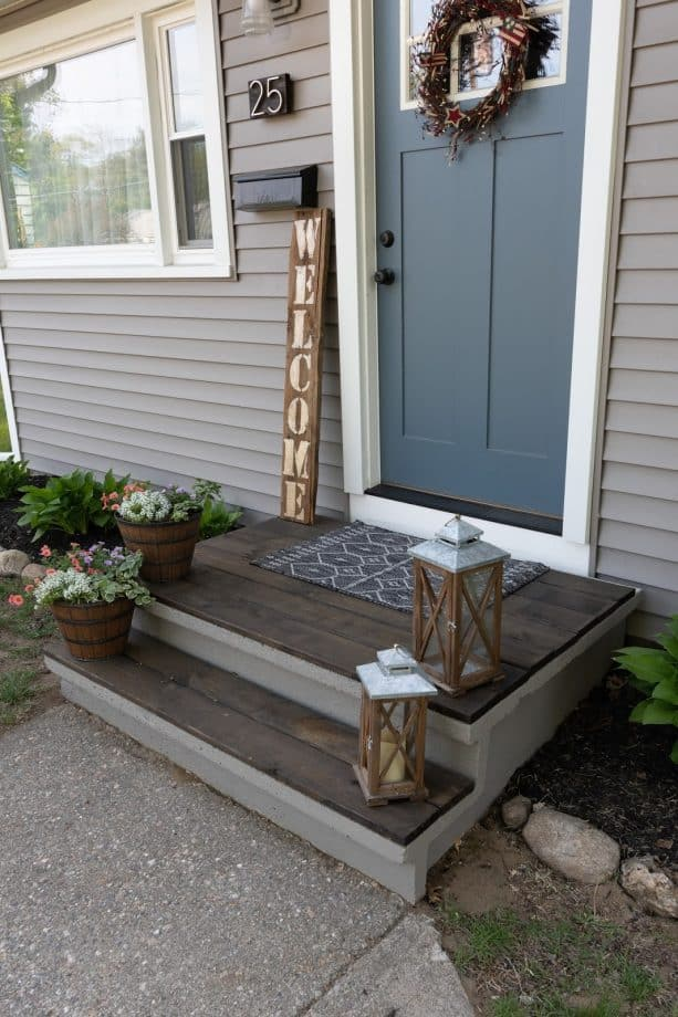 concrete front steps gain a new look after getting some wood panels installed on top of it