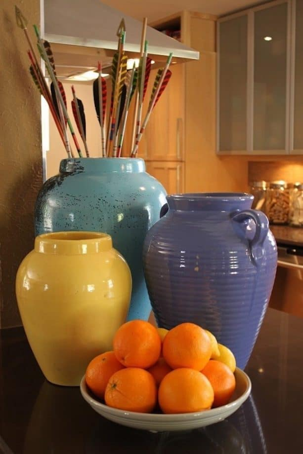 raised ranch kitchen with colorful oil jars
