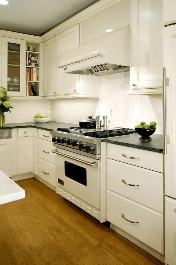 traditional kitchen with antique white cabinets and white appliances