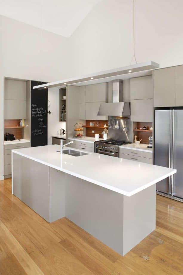 clean grey kitchen with medium tone wood for the backsplash