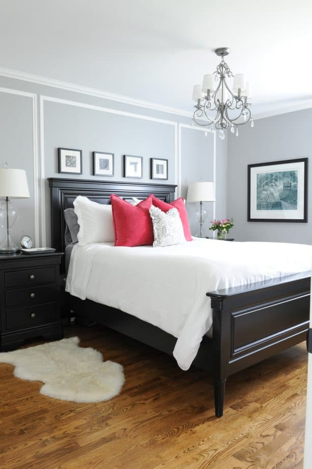 grey and red bedroom with black bed and black nightstands