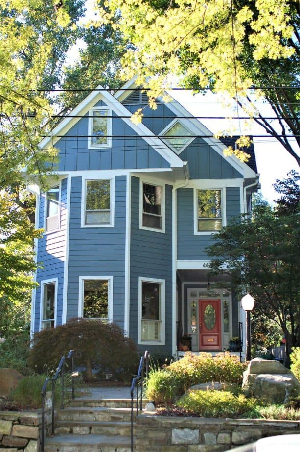 a two-story farmhouse exterior with Boothbay Blue siding
