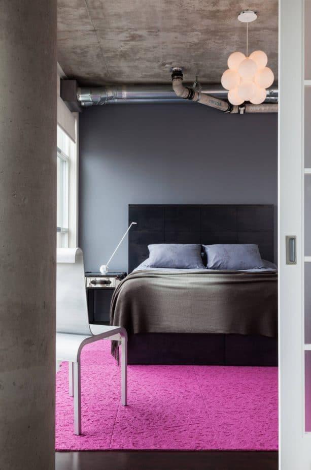 contemporary grey bedroom with pink area rug