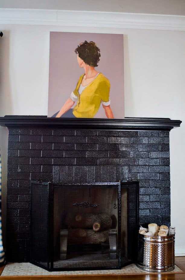 black brick fireplace with black mantel shelf