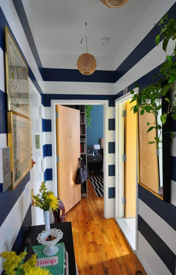 hallway with navy blue and white horizontal stripes wall