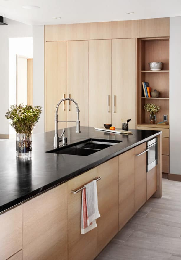 a contemporary kitchen with rift-sawn light oak cabinets and benjamin moore nimbus 1645 wall paint