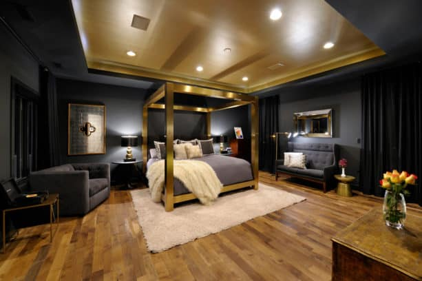 a luxurious eclectic bedroom with black, gold, and grey colors