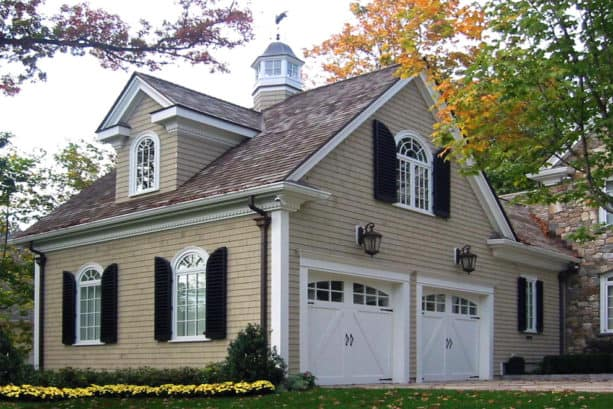 home exterior with tan wall siding and black shutters