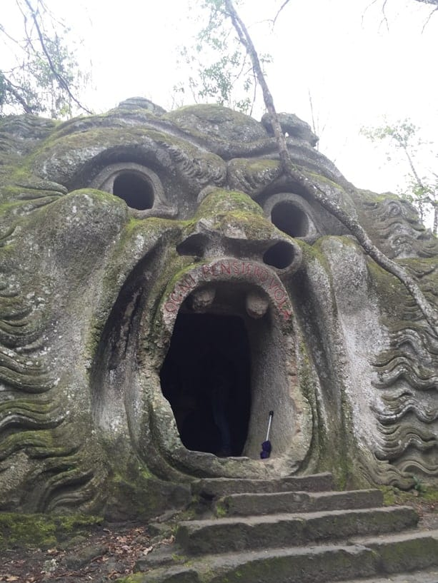 A monster's open mouth acts as cave.