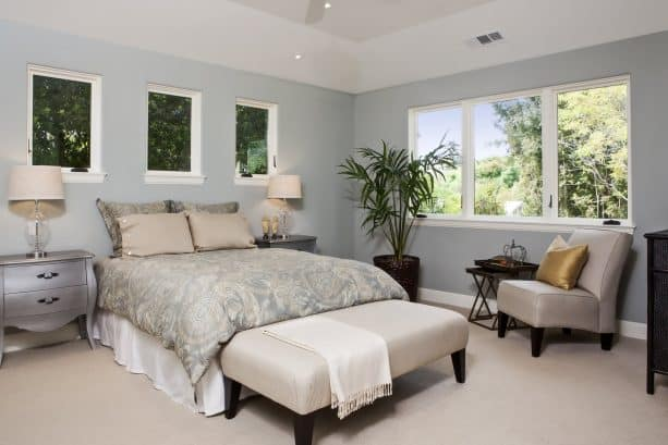 contemporary bedroom with Benjamin Moore Tranquility AF-490 grayish blue wall paint color