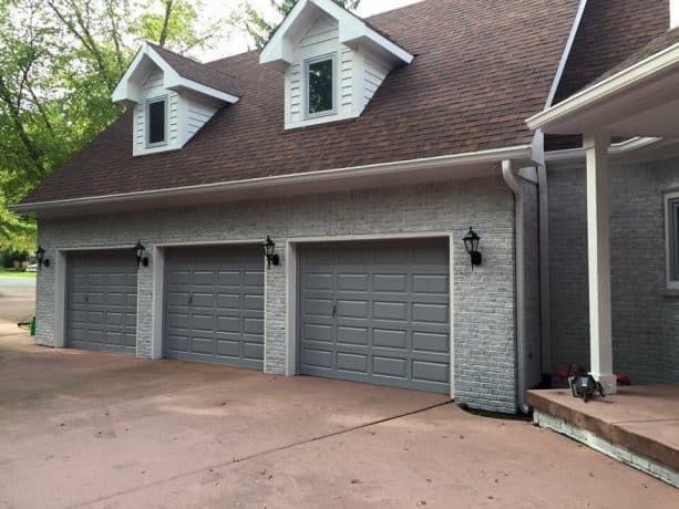 home exterior look with color-washed grayish brick walls and fossil gray doors