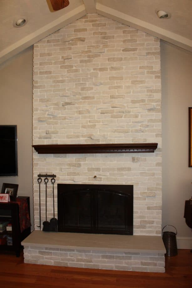 after makeover whitewashed traditional floor to ceiling brick fireplace with black insert with cover