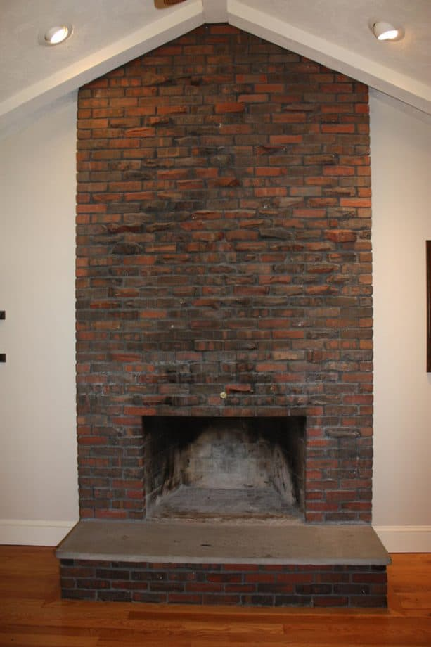 before makeover traditional floor to ceiling brick fireplace no insert
