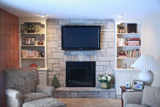 family room after being remodeled with new floor to ceiling fireplace design