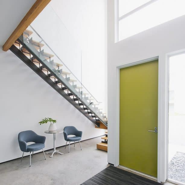modern entry with olive green door and white trim paint color