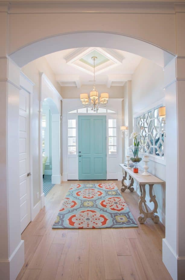 transitional entry with sky blue door and white trim paint color