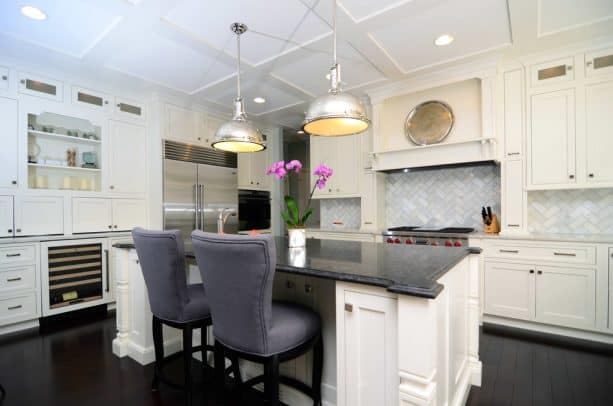 contemporary kitchen with antique white cabinets and stained brazilian cherry hardwood flooring