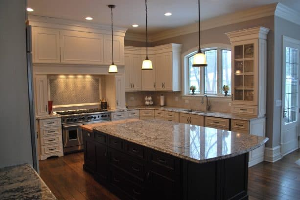traditional kitchen with antique white cabinets and benjamin moore revere pewter gray wall color