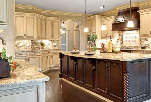 traditional kitchen with antique white cabinets and hickory brown island