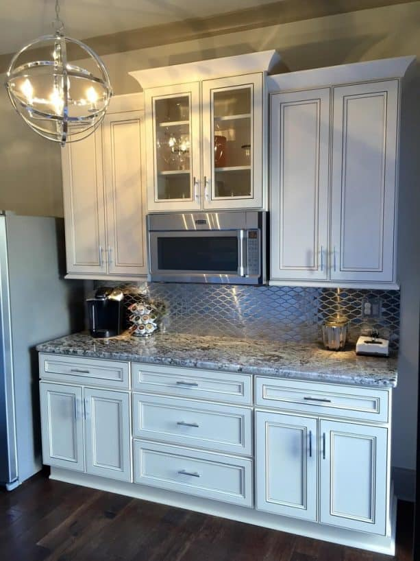 traditional kitchen with antique white cabinets and tubular metal bar pulls