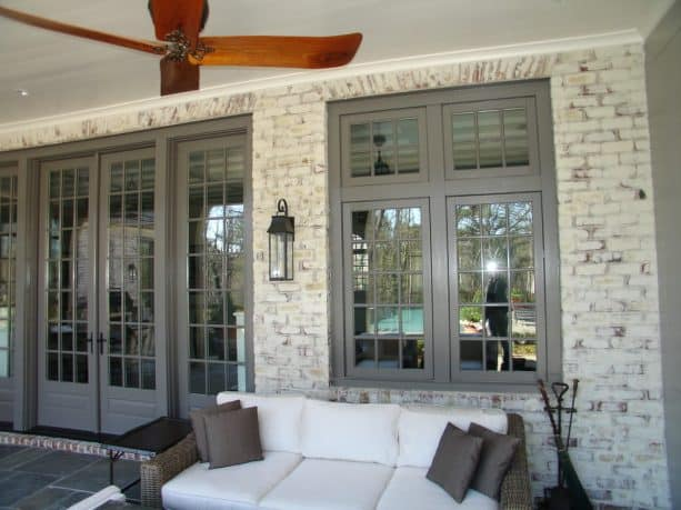 traditional porch with lime-washed brick wall