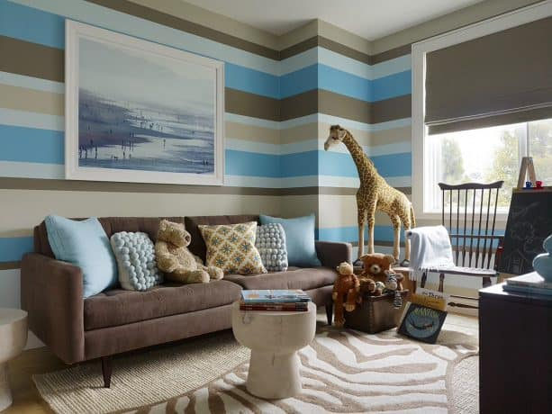 contemporary living and playroom with large blue-themed wall painting and coffee brown couch color ideas