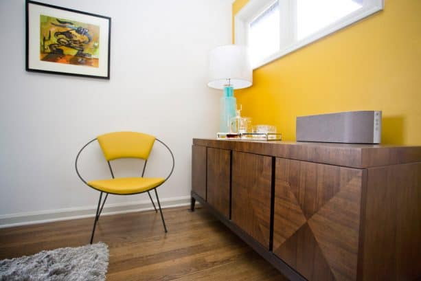 contemporary living room with butter yellow accent wall